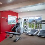 Stair Stepper and Treadmill in Fitness Center - The Ridge Apartments in Sandy - Midvale, Utah