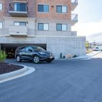 car exiting parking garage at The Ridge Apartments in Sandy - Midvale, Utah